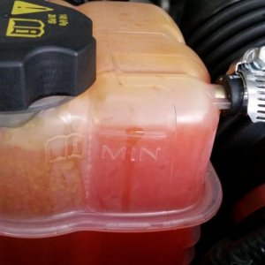"Coolant reservoir with no ""MAX"" fill line"